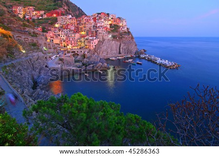 Wide view of Manarola at the blue hour - stock photo