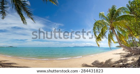 Wide view of tranquil tropical island beach - stock photo