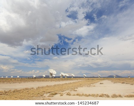 Wide view of Very Large Array near Socorro New Mexico under bright blue skies - stock photo