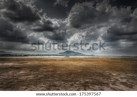 widely field, mountain and cloud in dramatic - stock photo