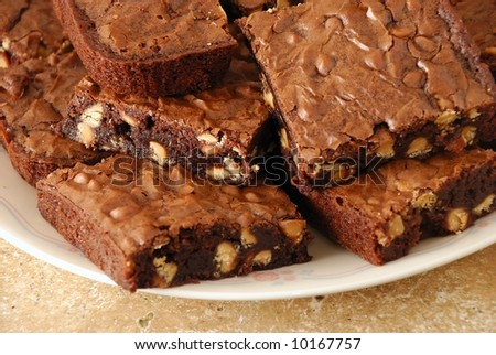 wider-angle view of freshly made brownies - stock photo