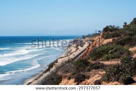 Wideshot of the Del Mar, California coastline, with ocean, cliffs and railroad tracks. - stock photo