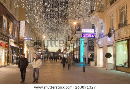 WIEN, AUSTRIA, JANUARY 3, 2015: people are walking through kohlmarkt street in wien which is decorated with christmas lights. - stock photo