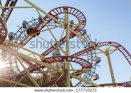 Wiener Riesenrad Ferris Wheel and Roller Coaster in the Prater amusement park in Vienna, Austria - stock photo