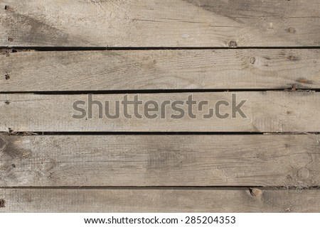 Wiev of old wood planks, horizontally arranged. Wooden background. Pallet carrier or rack. - stock photo