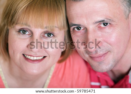 Wife and husband in middle age smiling - stock photo
