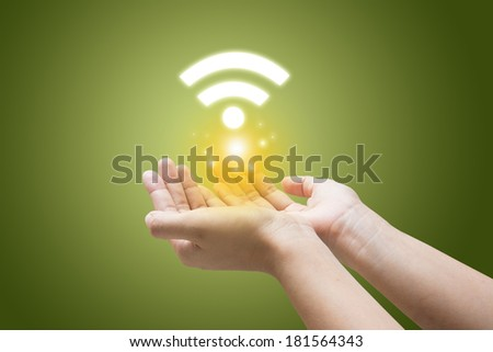Wifi symbol in a hand businessman  - stock photo