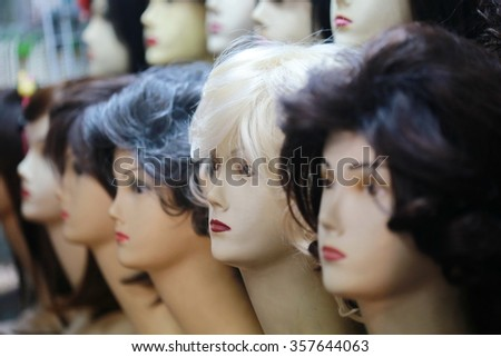 wigs on mannequin heads - stock photo