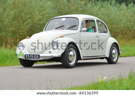 WIJHE, THE NETHERLANDS - SEPTEMBER 4: A Volkswagen Beetle 111011 from 1969 drives past at the 10th Diekdaegen classic car tour on September 4, 2011 in Wijhe, The Netherlands - stock photo