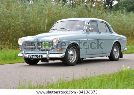 WIJHE, THE NETHERLANDS - SEPTEMBER 4: A Volvo Amazon P12194 from 1965 drives past at the 10th Diekdaegen classic car tour on September 4, 2011 in Wijhe, The Netherlands - stock photo