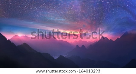 Wild alpine peaks rows away to the horizon, forming a magical panoramic view, resulting in amazement climber.Whirling stars at slow shutter speeds  sunsets against the mountain waves - just incredible - stock photo
