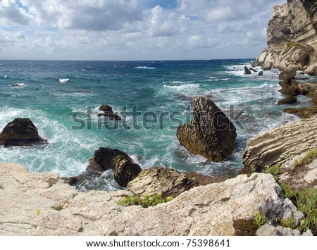 Wild and beautiful coast of c Corsica with spectacular stone formations in the sea - stock photo