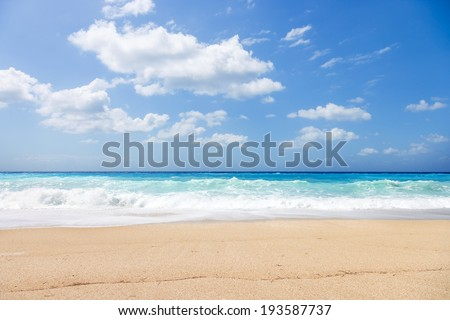 wild beach of the island of Lefkada in Greece with water crashing on the rocks - stock photo
