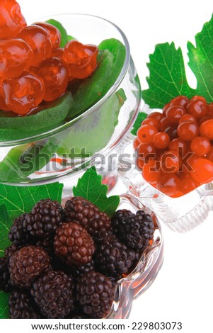 wild berry over white background in glass - stock photo