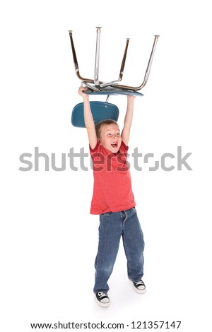 Wild Boy holding a chair over his head - stock photo