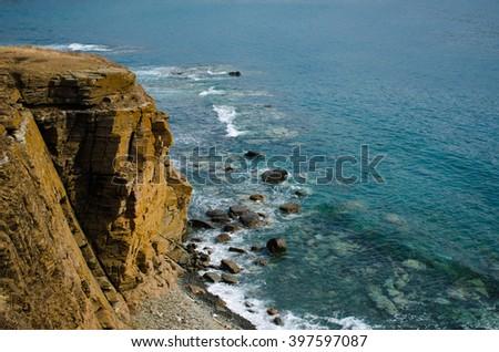 wild cliffs along Pacific ocean - stock photo