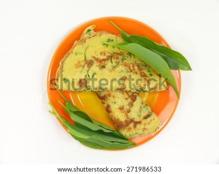 wild garlic pancakes on the plate - stock photo