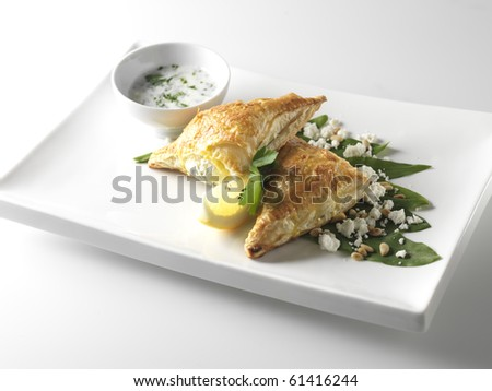 Wild garlic pockets with cottage cheese - stock photo