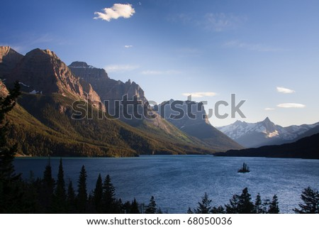 Wild Goose Island sits in the middle of a windy Saint Mary Lake, Glacier National Park, Montana. - stock photo