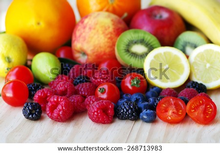 Wild ripe fruits on table - stock photo