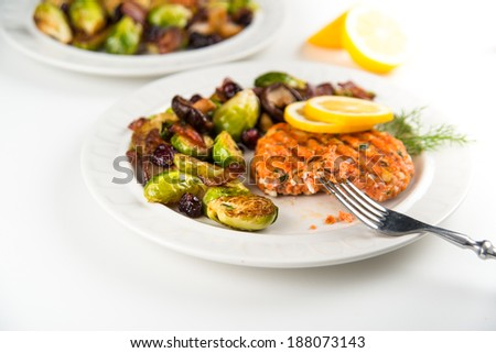 Wild Salmon Patty Served with Brussels Sprouts and Mushroom Hash  - stock photo