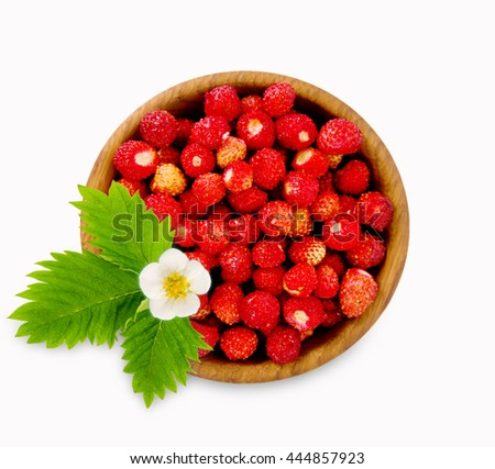 Wild small strawberry in a wooden bowl. Ripe and tasty strawberry isolated on white background. Sweet and juicy berry. Berry useful for strengthening the immune system. Top view. - stock photo