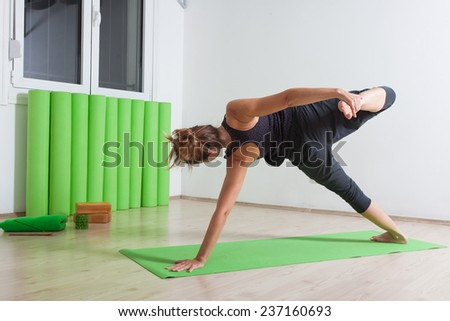 Wild thing variation yoga pose - stock photo