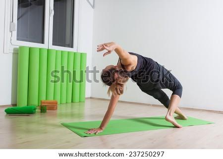 Wild thing yoga pose - stock photo