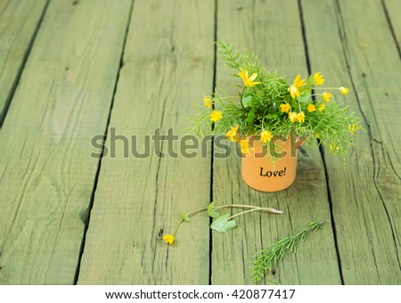Wildflowers. Flowers in a vase. Flower. Yellow Wild flowers.Yellow Wildflowers. Wild flowers on wooden table. Bouquet of Wildflowers. Green Vintage floral background with Wild flowers. Copy space - stock photo