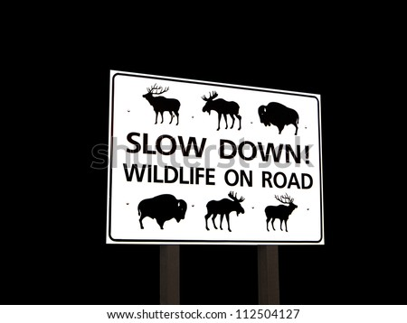 Wildlife on road sign with Moose, Bison and Elk isolated on a black background - stock photo