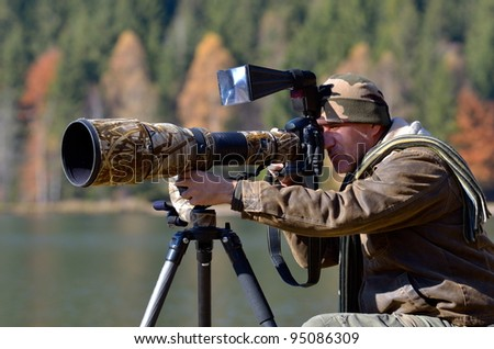 wildlife photographer outdoor in autumn - stock photo