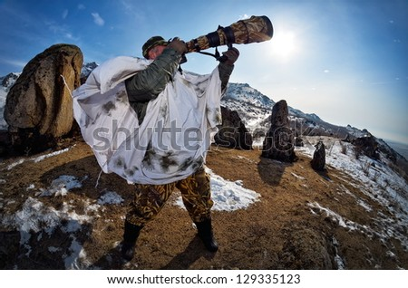 wildlife photographer outdoor in winter - stock photo