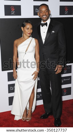 Will Smith and Jada Pinkett Smith at the 2nd Annual Diamond Ball held at the Barker Hanger in Santa Monica, USA on December 10, 2015. - stock photo