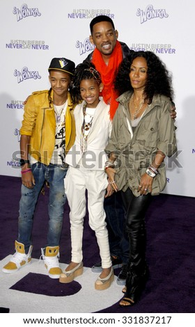 "Will Smith, Jada Pinkett Smith, Jaden and Willow Smith at the Los Angeles Premiere of ""Justin Bieber: Never Say Never"" held at the Nokia Theatre L.A. Live in Los Angeles, USA on February 8, 2011.  - stock photo"
