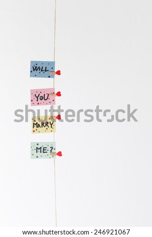 Will you marry me question pinned on rope - stock photo