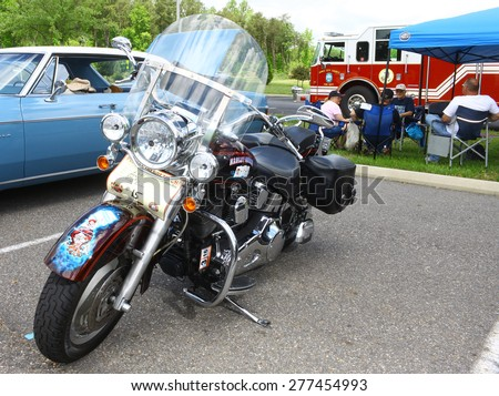 WILLIAMSBURG, VA - May 9, 2015: A Custom painted 1971 Harley Davidson fat boy at the 6th Annual Project Lifesaver Car Show in Williamsburg Virginia on a summer day. - stock photo