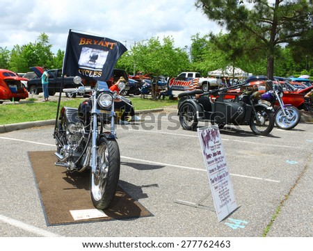 WILLIAMSBURG, VA - May 9, 2015: A row of three motorcycles at the 6th Annual Project Lifesaver Car Show in Williamsburg Virginia on a summer day. - stock photo