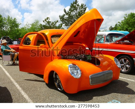 WILLIAMSBURG, VA - May 9, 2015: An orange 1941 Willis Coupe with a Chevy LS2 smallblock at the 6th Annual Project Lifesaver Car Show in Williamsburg Virginia on a summer day. - stock photo