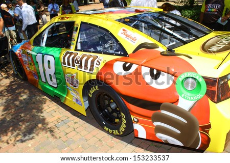 WILLIAMSBURG, VA- SEPTEMBER 5: The Kyle Busch #18 NASCAR race car at the 1st History meets Horsepower show in Williamsburg, Virginia on September 5, 2013 - stock photo