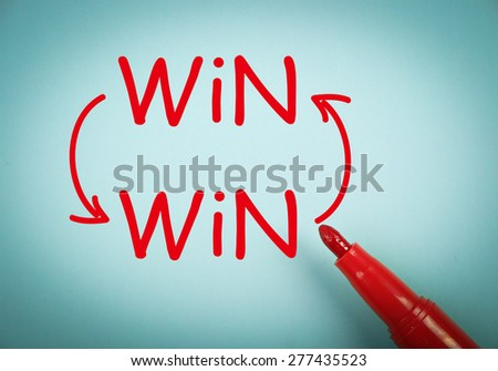 Win win concept is on blue paper with a red marker aside. - stock photo