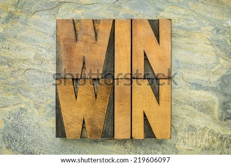 win-win - negotiation or conflict resolution strategy  -  words in letterpress wood type against slate rock background - stock photo