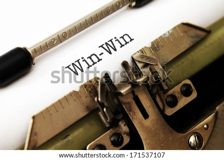 Win win text on typewriter - stock photo