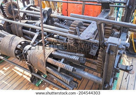 winch mechanism on an old sailboat - stock photo