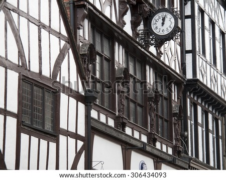 Winchester, High Street, Hampshire, England - August 15, 2015: Historic Elizabethan buildings over retail shops  - stock photo