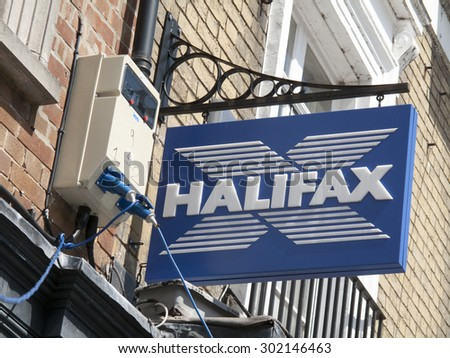 Winchester High Street, Hampshire, England - July 31, 2015: Halifax bank Previously Halifax Building Society and owned by Lloyds Banking Group sign situated on building wall - stock photo