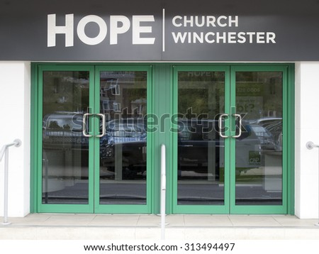 Winchester, Middle Brook Street, Hampshire, England - September 4, 2015: Church of England Hope church entrance located in a former Art Deco cinema - stock photo