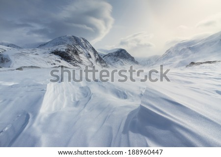 Wind an clouds over the frozen snow in Lapland, Sweden. - stock photo