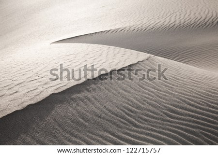wind and sand texture on the dunes - stock photo