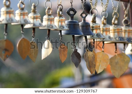 WInd bells hung in a temple in Nepal - stock photo