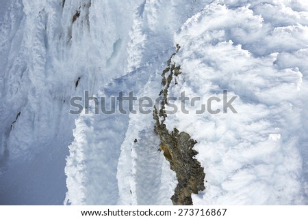 Wind Blown Frozen Snow and Rocks at the Top of Mt Baker - stock photo